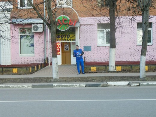 A supporter of United Russia handing out leaflets in the street