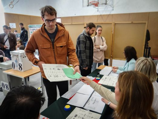 A voter in Budapest receiving his ballot for Hungary's parliamentary elections. (OSCE/Thomas Rymer)