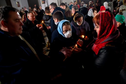 Candlelight ceremony during Easter. Cathedral in Vitebsk during the COVID-19 pandemic.