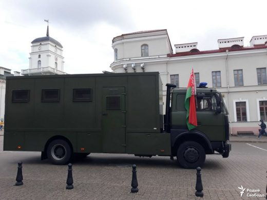 Police van in Minsk decorated by the red-green flag. August 2020, Minsk. Photo: Radio Free Europe.