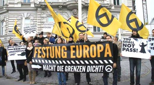 Far-right activists at an identitarian movement of Austria anti-immigration rally in Vienna.