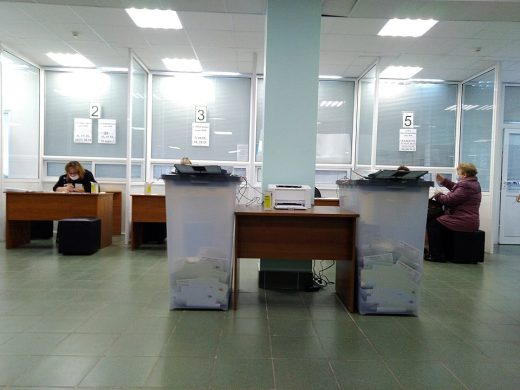 Two automated ballot boxes stuffed with ballots in a polling place 862.